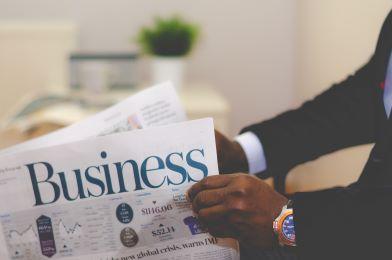 business finance man reading business newspaper